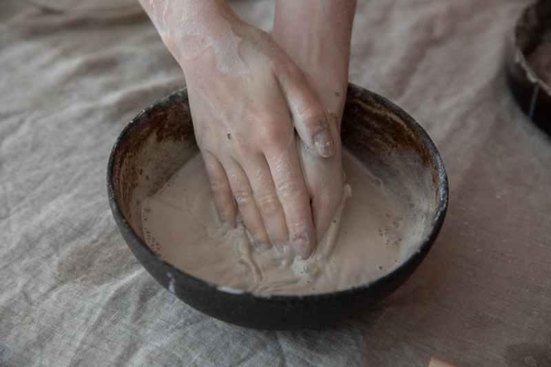 crop artisan preparing clay for pottery in workshop