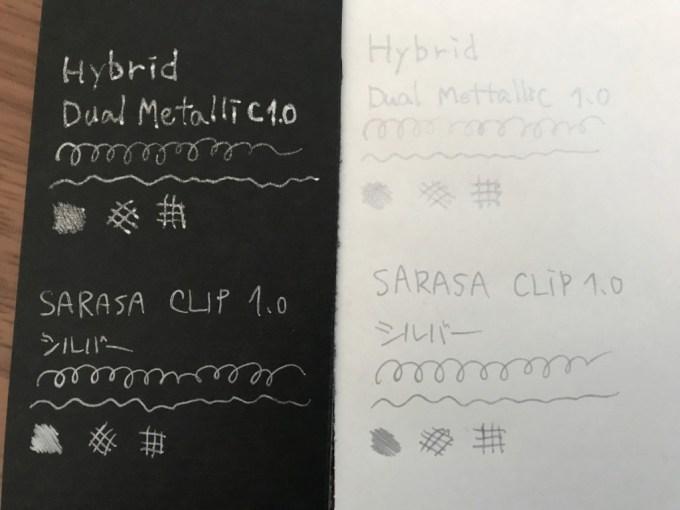 銀ペン白と黒の紙に描いた字