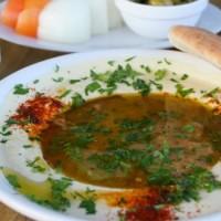 Akciós hummusz egy vendéglőben, ha ülnek le a zsidó és arab vendégek