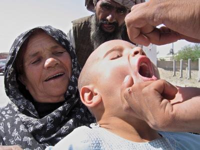 Child receiving oral polio vaccine drops in Balochistan, Pakistan