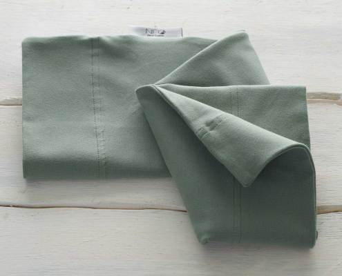 The almond green skin to skin kangaroo wrap is recommended by childcare untis for full term or premature babies