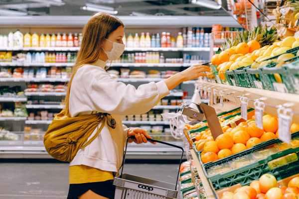 woman in white long sleeve shirt shopping