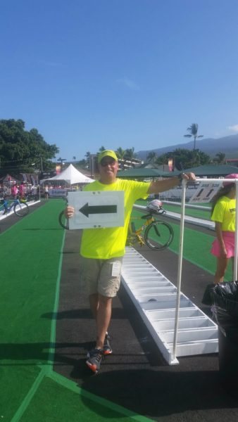 One of the many volunteers needed for the 2016 IRONMAN World Championships.