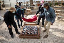 Israeli archaeologist Assaf Avraham and colleagues unveil a replica of flooring of Jerusalem's Roman-era Jewish temple, near Jerusalem's Old City November 16, 2020. REUTERS/Amir Cohen