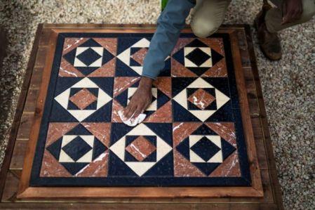 Israeli archaeologist Assaf Avraham polishes a replica of flooring of Jerusalem's Roman-era Jewish temple, near Jerusalem's Old City November 16, 2020. REUTERS/Amir Cohen