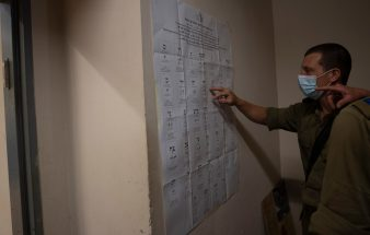 Israeli soldiers cast their votes in early elections at their base in Kafr Qara