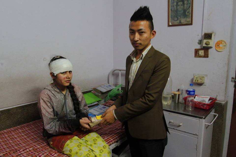 Handing over the donation to Sima Basnet, the Basantpur acid attack victim