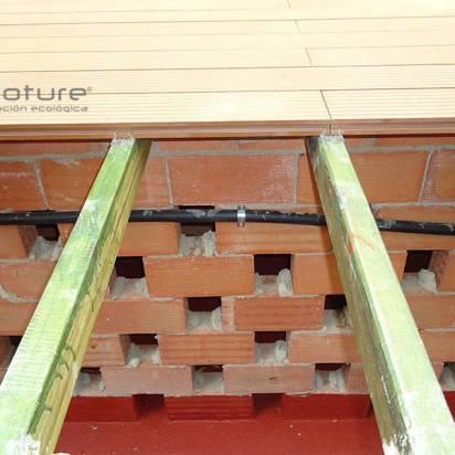 montaje de tarima exterior composite sobre estructura metalica