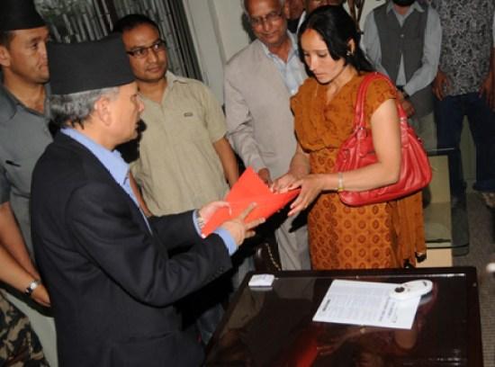 Baburam Bhattarai listening to Amar Bahadur Bam's Wife
