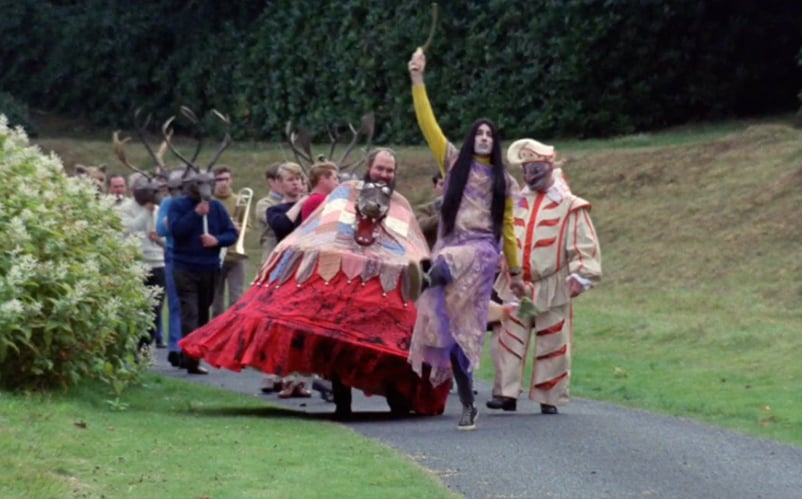 You didn't know that Christopher Lee leading a parade in a cute party dress was something you needed in your life - but now you do.