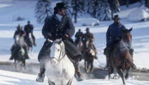 Red Dead Redemption 2 - Riding through a winter landscape.