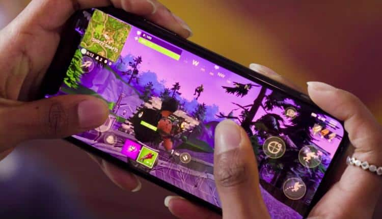 A photograph of someone playing Fortnite Battle Royale on mobile
