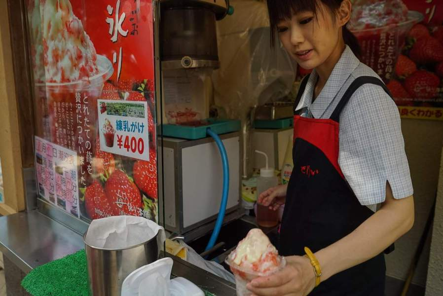 A woman selling shaved ice at Miyajima Island