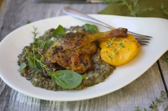 Crispy Spiced Duck Legs with Honey and Thyme Roasted Peaches.