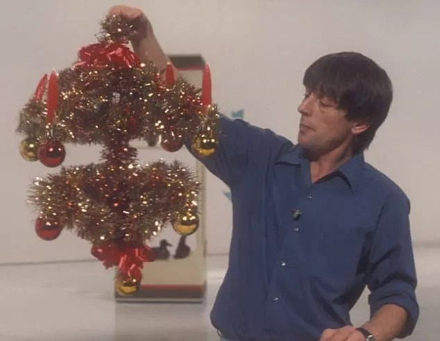 John Noakes in a studio with a homemade Christmas advent candle