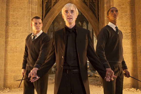"""In this film publicity image released by Warner Bros. Pictures, from left, Josh Herdman portrays Gregory Goyle, Tom Felton portrays Draco Malfoy and Louis Cordice portrays Blaise Zabini in a scene from """"Harry Potter and the Deathly Hallows: Part 2."""" (Warner Bros. Pictures, Jaap Buitendijk)"""