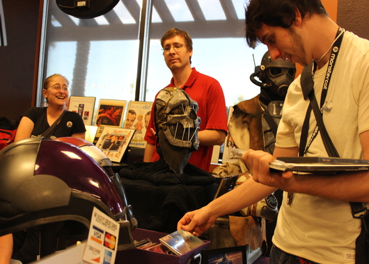An art booth was set up to showcase video game prints and cosplay armor.