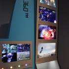 An early model of the Xbox 360 and several games being showcased.