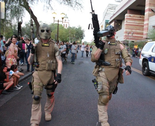 Elliot Salem and Tyson Rios from Army of Two in the zombie walk. (Photo by Christen Bejar)