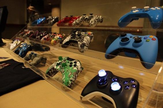 Various custom controllers on display in the AZHP Gaming room.