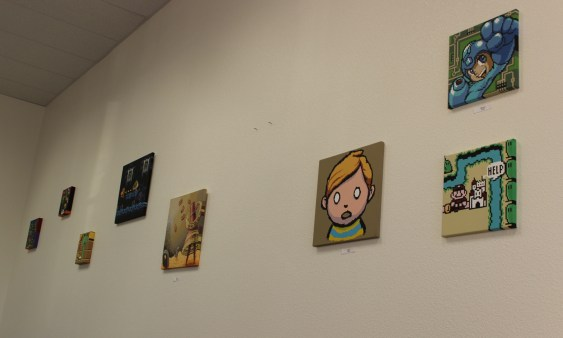 The walls of the bar are decorated with art from various video games.
