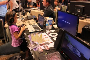 Always gaming: a young attendee plays AZVGs showcase games. [photo by Christen Bejar]