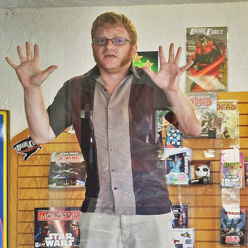Comic creator Russ Kazmierczak in Drawn to Comic window (courtesy Susan Brown, Drawn to Comics.)