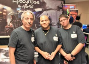 Mike Weiser stands with his Epocylipse team members at their Phoenix Comicon booth.