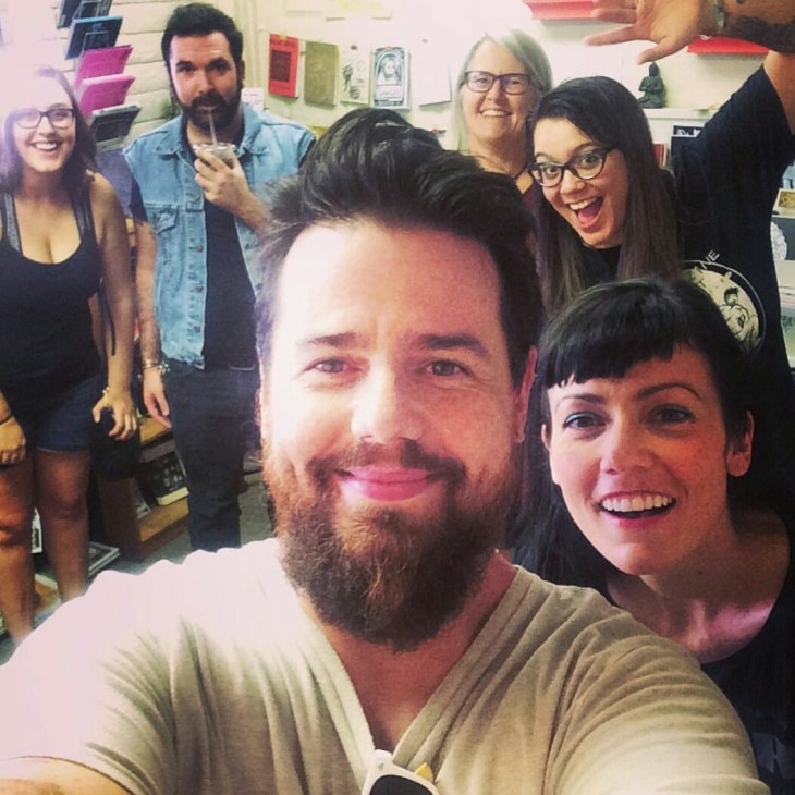 Brodie with the curaters and patrons of Tempe's Wasted Ink Zine Distro