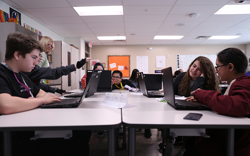 Students in this Phoenix Coding Academy history class are searching the web for current events. The academy specializes in computer science. (Photo by Christopher Silavong/Cronkite News)