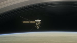 In the still from the short film Cassini's Grand Finale, the spacecraft is shown diving between Saturn and the planet's innermost ring. (Courtesy NASA/JPL-Caltech)