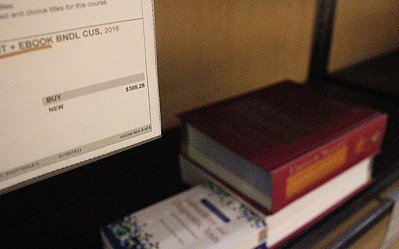 Caitlin Lindberg, a student and employee at the Scottsdale Community College bookstore said prices of textbooks can cost hundreds of dollars. (Photo by Devon Cordell/ Cronkite News)