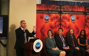 University of Arizona astronomy professor David Sand with other scientiests at a National Press Club event where they talked about the discovery of a kilonova, a massive collision of two neutron stars. (Photo by Isaac Windes/Cronkite News)