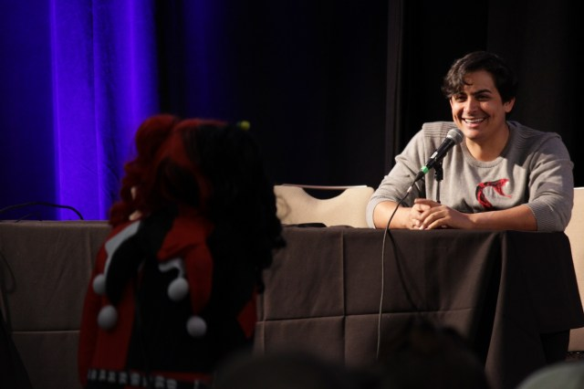 Robbie Daymond jokes with an cosplaying attendee during his panel.