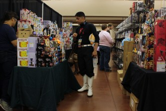 This Team Rocket cosplayer perused anime merchandise in the Taiyou vendor area.