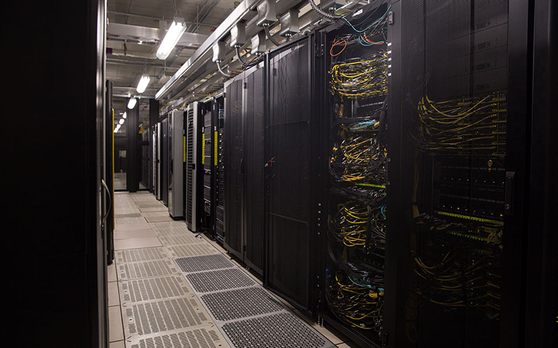 A fully outfited data center at Arizona State University's Interdisciplinary Science and Technology building contains equipment for Dragan Boscovic, a blockchain researcher who said he believes the technology will change the world's data and payment systems. (Photo by Jenna Miller/ Cronite News)