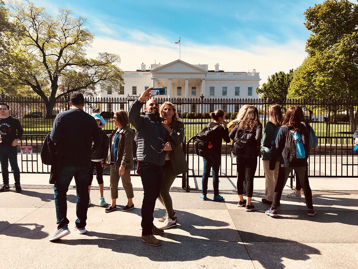 """A typical Washington scene, with tourists taking selfies outside the White House. With social media consuming more of our lives, some experts say they have seen problems with users who can suffer depression or anxiety as they look other people's """"perfect"""" lives. (Photo by Shelby Lindsay/Cronkite News)"""