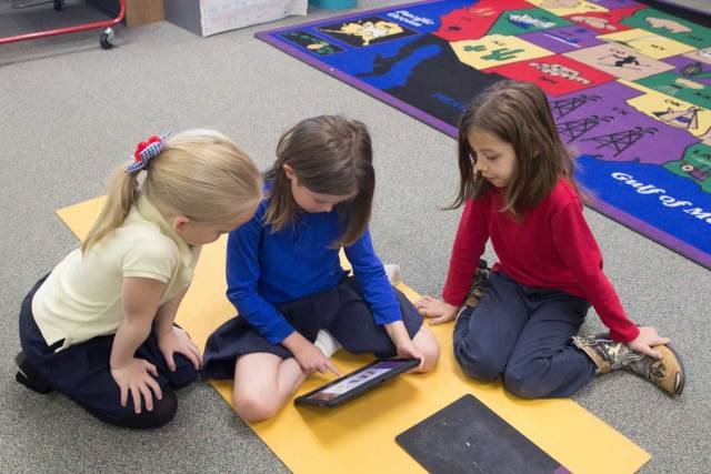 First-grade students at Congress Elementary School use iPads as part of class instruction. Improvements to bandwidth allows them to work at school and at home. (Photo by Faith Miller/Cronkite News)