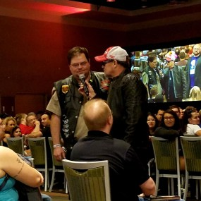 Michael Rooker talks with a fan as he wades into the audience during his panel at Phoenix Comic Fest, Sunday, May 27, 2018, at the Phoenix Convention Center.