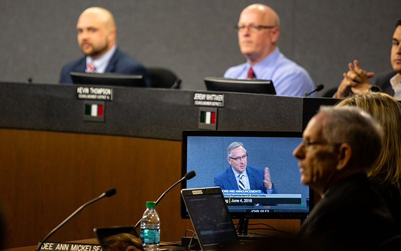 "The Mesa City Council voted 5-2 to open a new Arizona State University campus in downtown Mesa. Mayor John Giles, pictured on the computer screen, said Tuesday the campus is ""a perfect fit for what ASU needs and a perfect fit for what Mesa needs."" (Photo by Ellen O'Brien/Cronkite News)"