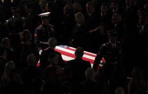 The Armed Forces Body Bearer Team escorts Sen. John McCain's the casket out of North Phoenix Baptist Church after a memorial service Thursday. (AP Pool Photo/Matt York)