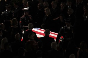 The Armed Forces Body Bearer Team escorts Sen. John McCain's the casket out of North Phoenix Baptist Church after a memorial service Thursday. (AP Pool Photo/Matt York)