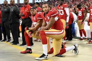 Colin Kaepernick (right) has remained a controversial figure after kneeling during the national anthem. His new deal with Nike has sparked debate again. (Photo by Thearon W. Henderson/Getty Images)