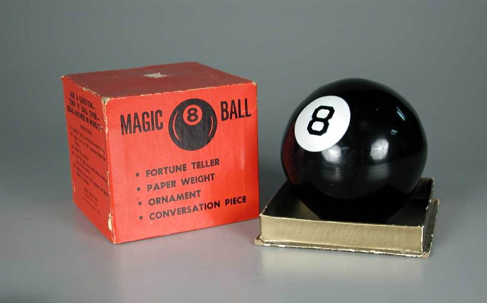 """Introduced in 1946, the Magic 8 Ball allows users to flirt harmlessly with fortune-telling. Users pose questions, shake the ball, and then read one of 20 answers that float to the surface at the bottom of the ball—ranging from """"ask again later"""" and """"signs point to yes,"""" to simply, """"no."""" The toy became an icon of popular culture, making its first television appearance on the Dick Van Dyke Show in the 1960s, and showing up later on hit series such as Friends and The Simpsons."""