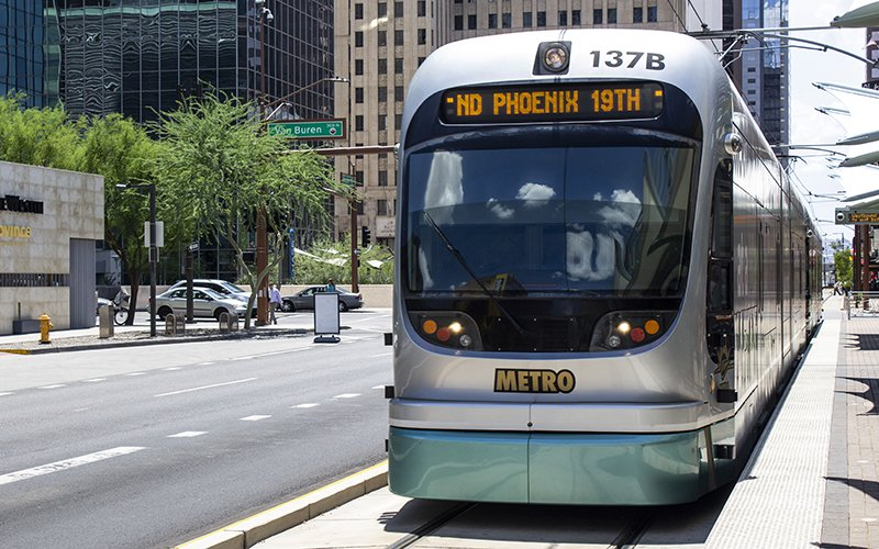 The westbound light rail pulls out of the Van Buren Street and Central Avenue station in downtown Phoenix. (Photo by Jordan Evans/Cronkite News)
