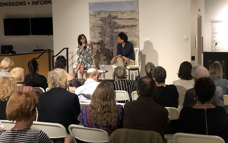 """Martha Sosa, the producer of such award-winning films as """"Amores Perros,"""" """"Presumed Guilty"""" and """"Plaza de la Soledad,"""" and Tucson Cine Mexico co-director Carlos Gutiérrez discuss nurturing new film talent at the festival's opening night Wednesday. (Photo by Nicole Ludden/Cronkite News)"""