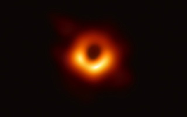 """The first-ever image of a black hole, an object in space that is so densely packed that not even light can escape its gravitational pull. University of Arizona researchers were on the global team of scientists that spent years to see """"the unseeable."""" (Photo by Event Horizon Telescope/National Science Foundation)"""