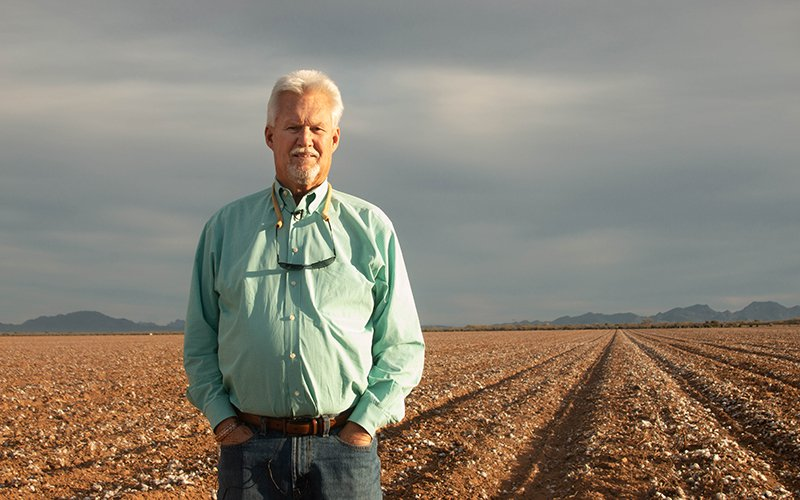 """Although Paul """"Paco"""" Ollerton has spent almost his entire life on a cotton farm, he's considering growing hemp this summer. """"Even though I've been here 38 years, we (still) don't know everything about cotton."""" (Photo by Meg Potter/Cronkite News)"""