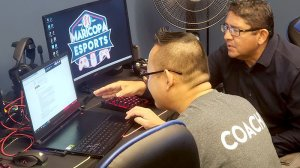 Maricopa Esports League coach Jack Ngan (left) is among those involved in a groundbreaking parks and rec program that is city sponsored. (Photo by Warren Younger/Cronkite News)