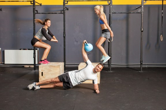Fitness training - box jump and kettlebell training
